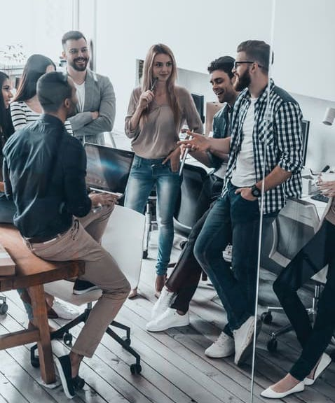 Group of marketers in a circle discussing a successful marketing campaign